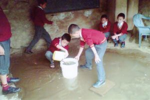 Students dealing with flooding