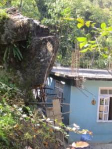 Rock hanging over school building