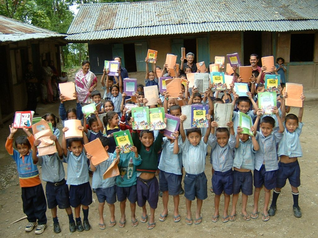 Schoolkids showing donated books