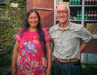 Laxmi Sherchn (left) and HELP volunteer Jim Dix in front of the Hotel Peaceful, Shikha, Nepal. Laxmi owns and manages the three-room hotel, in which Jim stayed during his three month stay.